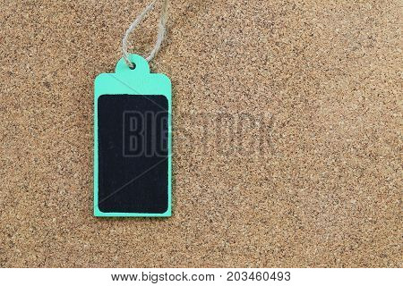 Green empty wood sign on wooden cork background for input text in your want and have copy space.