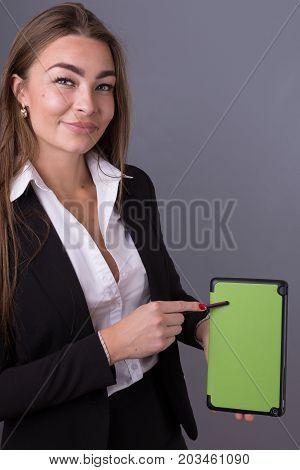 Attractive Businesswoman With Tablet Studying News And Presentation Ideas. Project Management And Co