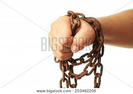 Close up fist hand with grunge rustic chain isolated on white background