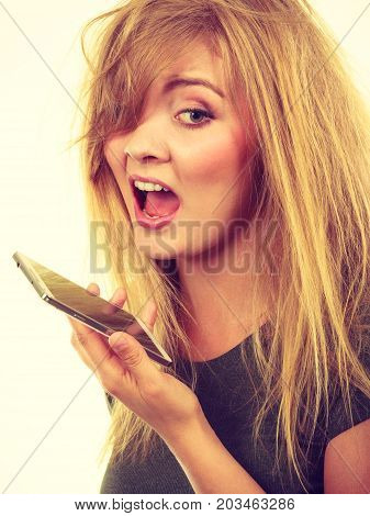Unpleasant conversation bad relationships concept. Screaming furiously angry young blonde woman talking on phone