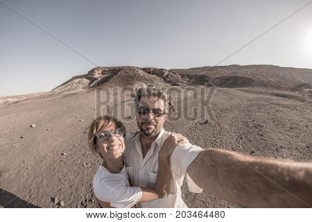 Smiling Adult Couple Taking Selfie In The Namib Naukluft National Park, Travel Destination In Namibi