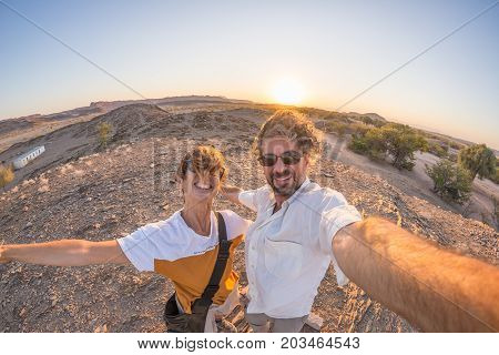 Smiling Adult Couple Taking Selfie In The Namib Desert, Namib Naukluft National Park, Travel Destina