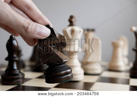 Wood Chess Piece Knight On Chessboard With Blurred Image And Vintage Color Tone Process , Competitio