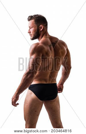 Handsome shirtless muscular man's back in briefs, standing, isolated on white background