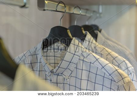 Clothes Hanging On Rail