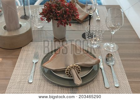 Table Set On Wooden Dining Room