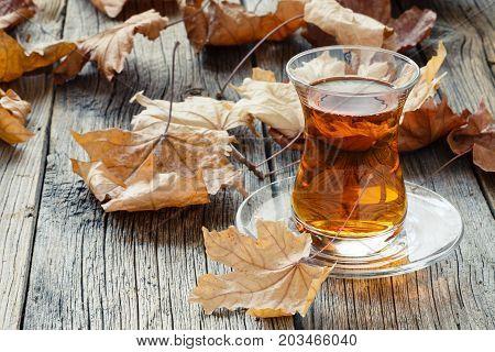 Fall tea drinking with turkish tea in glass