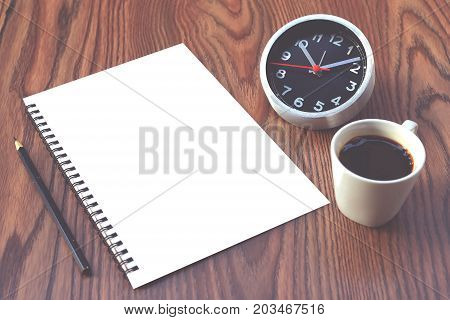 Concept Insights message on notebook with pencil and coffee cup on wooden table.
