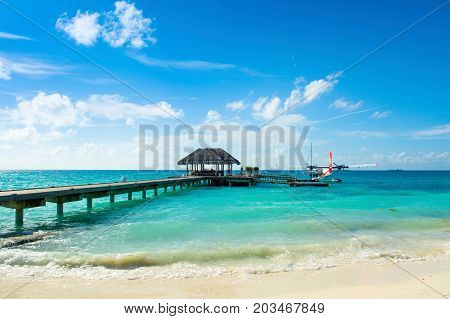 South Atoll Dhidhoofinolhu Maldives - July 04 2017: hydroplane near the wooden pier in Dhidhoofinolhu island