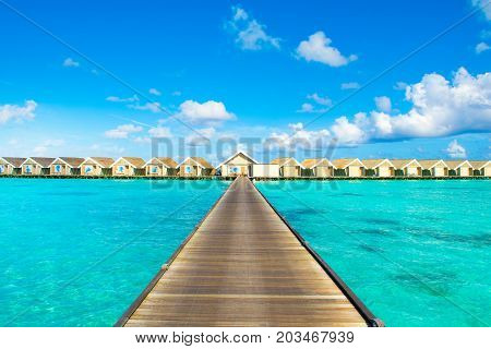South Ari Maldives - 8 July 2017: Beautiful tropical landscape. Wooden villas over water of the Indian Ocean