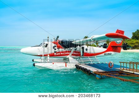 MALE MALDIVES - JULY 04 2017: hydroplane near the wooden pier at the Male airport