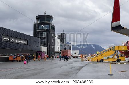 Longyearbyen Svalbard Norway - August 2017: Passengers disembark from the Norwegian aircraft at the Svalbard airport Longyear (LYR) - northernmost airport in the world with public scheduled flights. Airport operated by Avinor.