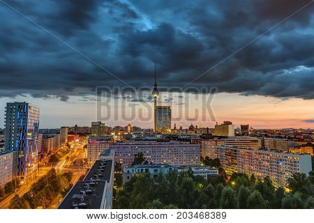 Dark sky over downtown Berlin at sunset with the Television Tower in the back