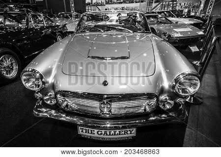 MAASTRICHT NETHERLANDS - JANUARY 09 2015: Sports car Maserati 3500 GT Spyder by Carrozzeria Vignale 1962. Black and white. International Exhibition InterClassics & Topmobiel 2015