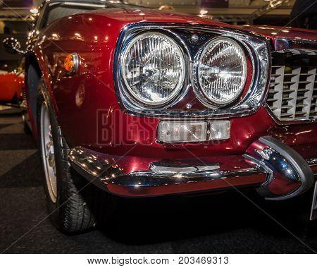 MAASTRICHT NETHERLANDS - JANUARY 09 2015: Headlamp of a sports car Maserati Mexico 4.2 (Tipo AM112) 1972. International Exhibition InterClassics & Topmobiel 2015