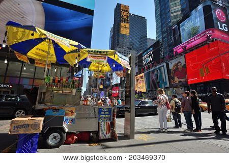 NEW YORK CITY USA - AUG. 24 : Street food cart in Manhattan on August 24 2017 in New York City NY. Manhattan is the most densely populated borough of New York City.