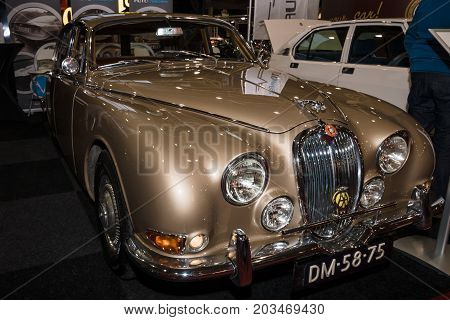 MAASTRICHT NETHERLANDS - JANUARY 09 2015: Sports saloon Jaguar S-Type 1965. International Exhibition InterClassics & Topmobiel 2015