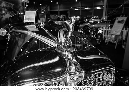 MAASTRICHT NETHERLANDS - JANUARY 09 2015: Hood ormament of a Auburn 8-100 Boattail Speedster Straight Eight 1931. Black and white. International Exhibition InterClassics & Topmobiel 2015