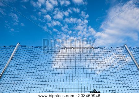 In the park there is a high safety net for football