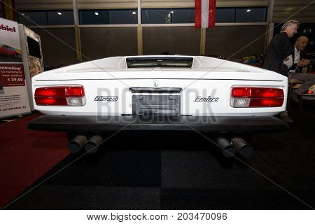 MAASTRICHT NETHERLANDS - JANUARY 09 2015: Sports car De Tomaso Pantera 1973. Rear view. International Exhibition InterClassics & Topmobiel 2015