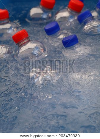 Pet Plastic Bottles Of Cold Drinking Water In Ice