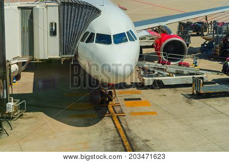 2016: Airport of Mallorca airplane in departure area during loading and refueling ready for departure.