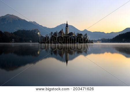 The island of Bled with the Assumption church reflecting on still water.