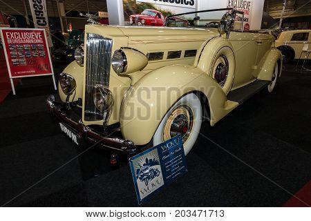 MAASTRICHT NETHERLANDS - JANUARY 09 2015: Oldtimer Packard 120 Convertible Sedan with Dietrich Body 1937. International Exhibition InterClassics & Topmobiel 2015