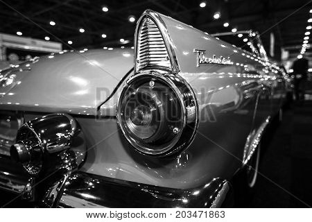 MAASTRICHT NETHERLANDS - JANUARY 09 2015: A stoplight of a personal luxury car Ford Thunderbird (first generation) 1955. Black and white. International Exhibition InterClassics & Topmobiel 2015