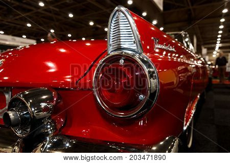 MAASTRICHT NETHERLANDS - JANUARY 09 2015: A stoplight of a personal luxury car Ford Thunderbird (first generation) 1955. International Exhibition InterClassics & Topmobiel 2015
