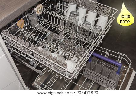 View from above on an open dishwasher with clean cup glasses and plates.