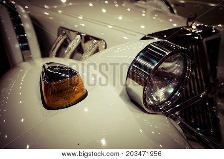 MAASTRICHT NETHERLANDS - JANUARY 09 2015: Fragment of a wedding limousine neo-classic car Cmc Tiffany built based on modern cars Ford. Stylization. Vintage toning. International Exhibition InterClassics & Topmobiel 2015