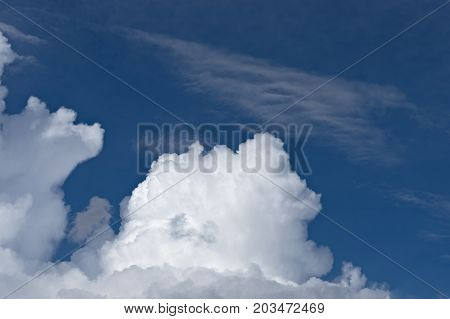 Fluffy white cumulus clouds on blue sky, background, close-up