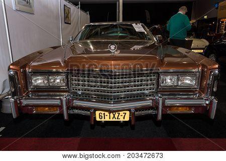 MAASTRICHT NETHERLANDS - JANUARY 09 2015: Full-size personal luxury car Cadillac Eldorado Biarritz 1976. International Exhibition InterClassics & Topmobiel 2015
