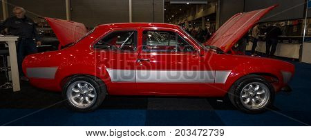 MAASTRICHT NETHERLANDS - JANUARY 09 2015: Small family car Ford Escort RS1600. Side view. International Exhibition InterClassics & Topmobiel 2015