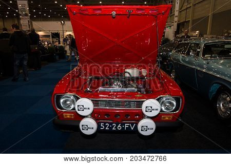 MAASTRICHT NETHERLANDS - JANUARY 09 2015: Small family car Ford Escort RS1600. Front view. International Exhibition InterClassics & Topmobiel 2015