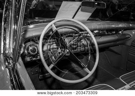 MAASTRICHT NETHERLANDS - JANUARY 09 2015: Cabin of a full-size car Buick Century Riviera convertible 1958. Rear view. Black and white. International Exhibition InterClassics & Topmobiel 2015
