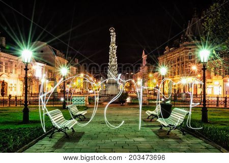 Plague column in Kosice city Slovak republic. Night scene. Writing with light - art technique. Architectural scene.