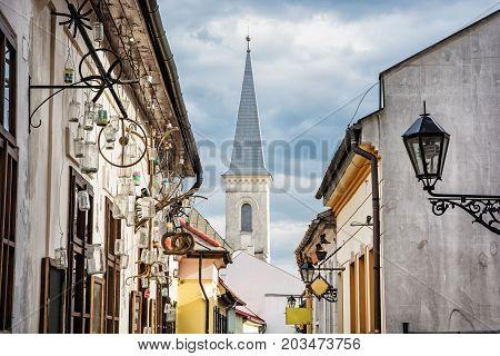 Hrnciarska street with Calvinist church in Kosice Slovak republic. Folk art theme. Religious architecture.