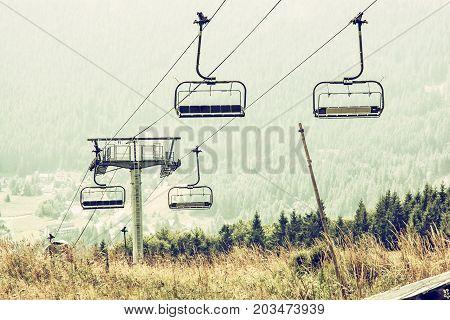 Cableway Donovaly Slovak republic. Tourism theme. Mountains scene. Retro photo filter.