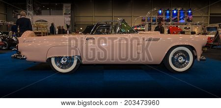 MAASTRICHT NETHERLANDS - JANUARY 09 2015: A personal luxury car Ford Thunderbird (first generation) 1955. Side view. International Exhibition InterClassics & Topmobiel 2015