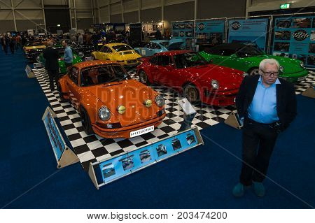 MAASTRICHT NETHERLANDS - JANUARY 09 2015: The main pavilion. Various Porsche 911 and 964 different years of production. International Exhibition InterClassics & Topmobiel 2015
