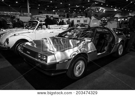 MAASTRICHT NETHERLANDS - JANUARY 09 2015: Sports car DeLorean DMC-12. Black and white. International Exhibition InterClassics & Topmobiel 2015