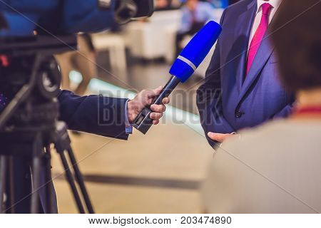 The Reporter's Hand Holds The Microphone. Takes An Interview