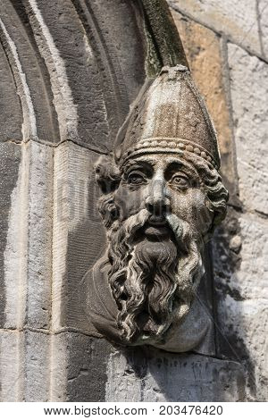 Dublin Ireland - August 7 2017: Closeup of statue of bishop head on side of entrance to church at The Castle.