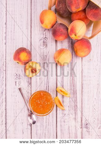Peach Jam On Wooden Background; Selective Focus