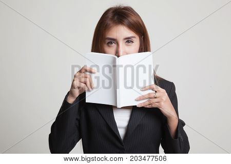 Young Asian Woman With A Book.