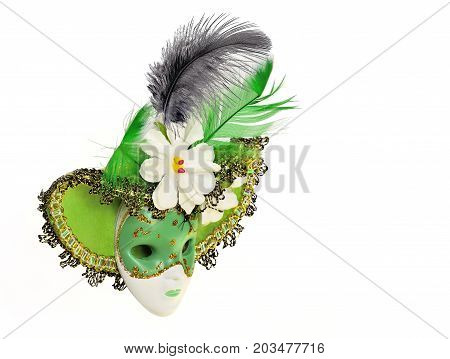 Vintage green carnival mask with hat flowers and feathers isolated on a white background