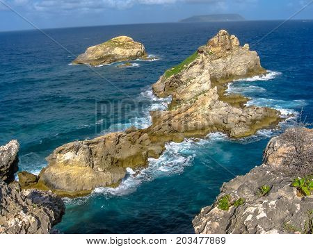 Rocks along Pointe des Chateaux located in the extreme east of the mainland 11 km from Saint-Francois in Guadeloupe, Grande Terre, Caribbean.