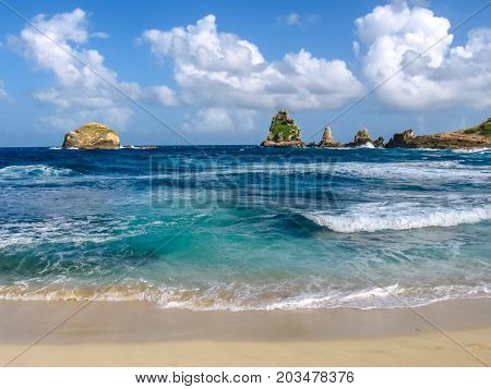 The Salines Bay beach in front of the cliffs of Castle Point located in the extreme east of the mainland 11 km from Saint-Francois in Guadeloupe, Grande Terre, Caribbean. poster
